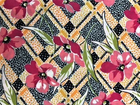 Rosa blomster på gul/sort bunn