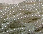 Vaxad glaspärla vit