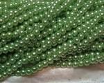 Vaxad glaspärla ljusgrön