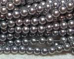Vaxad glaspärla grå