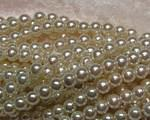 Vaxad glaspärla off white