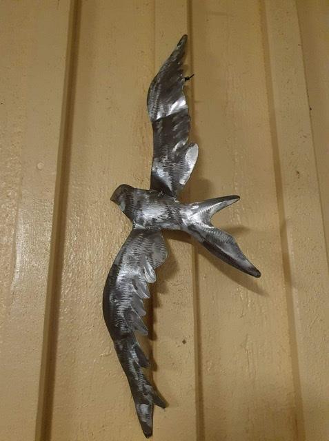 Fågel vägg plåt