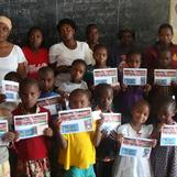 Some of the sponsored students with picture of their sponsors