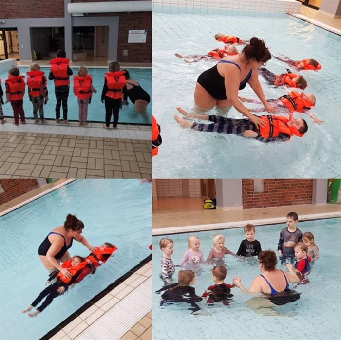 Miniflytar simmar med räddningsväst