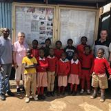 Sponsored students at Red Rose School together with Headmaster