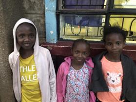 Three sisters waiting at Kibera Citadel