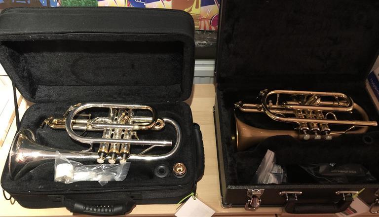 Two good cornets; 1 Axxon & 1 Carol Brass