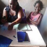 Mitchelle med lärare / Mitchelle with teacher