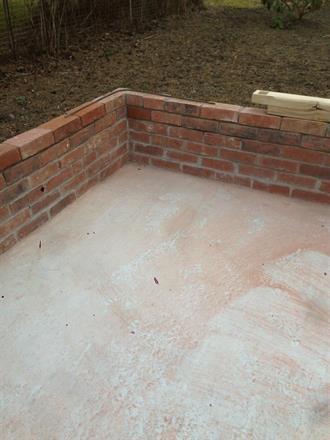Här muras tegelmuren