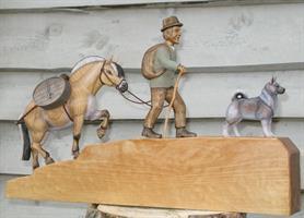 Mann m/ hest og hund