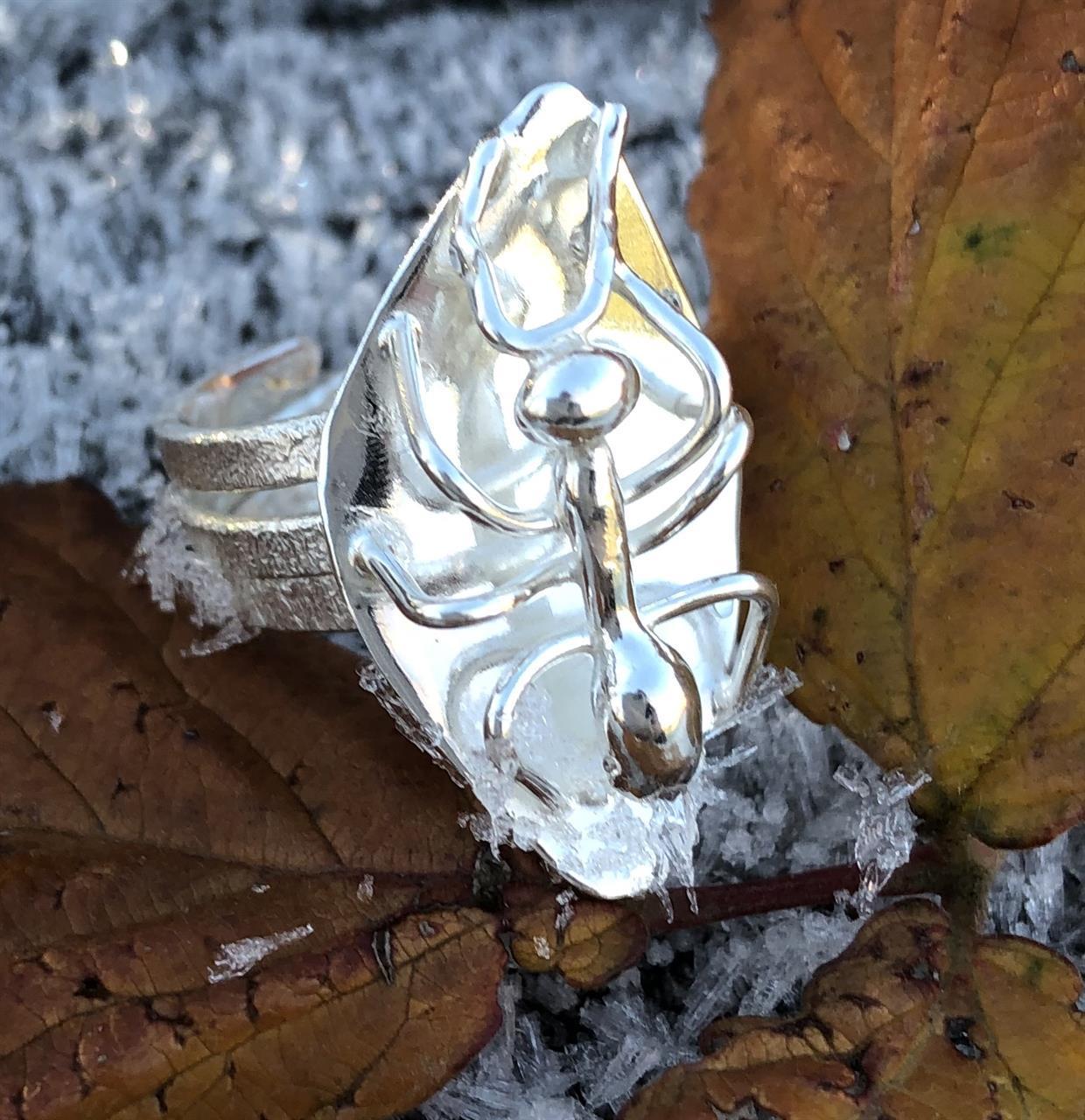 Handgjord och ställbar silvering med myra.