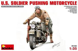 U.S.  SOLDIER PUSHING MOTORCYCLE