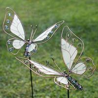 Fjäril, självlysande, på stick