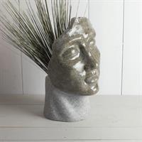 Kruka ansikte, skulptur