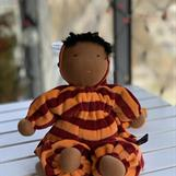 Large hug doll with a hood in a new redbrown skin color and unique dress fabric - SEK 300