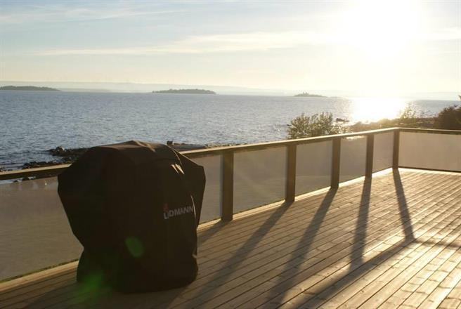 Havsfjärden - solnedgång med lågt ljus dämpar genomsikten,..
