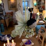 Small guardian angel with a black braid and golden dress! - SEK 100
