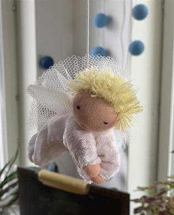 Large guardian angel with blond short hair