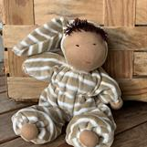 Middle sized Waldorf hug doll with a hood, brown hair and dark skin