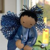 Large guardian angel with one black tassel and dark skin