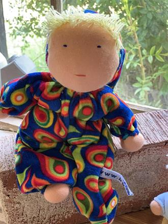 Middle sized Waldorf hug doll with a hood and blond hair - SEK 250