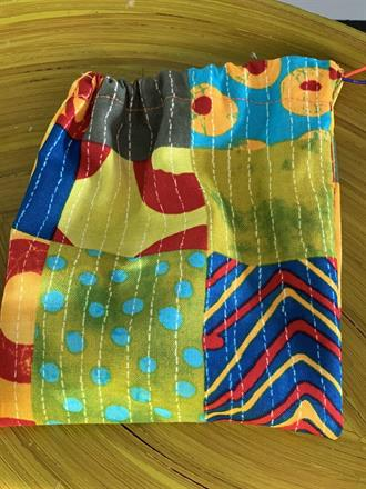 BAG (here the back) WITH THREE DOLLS - 150 SEK