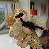 Large golden guardian angel with black braids - SEK 130