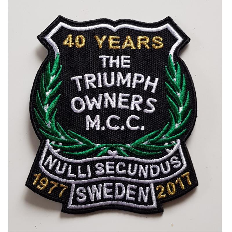Tygemblem TOMCC 40 Years