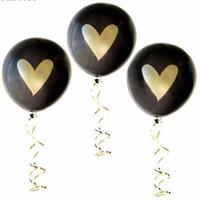 10 stk Ballong med hjerte i svart og gullfarge.
